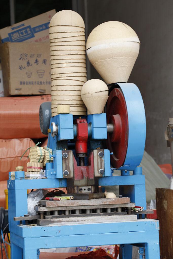 A machine that creates firework cardbord shells