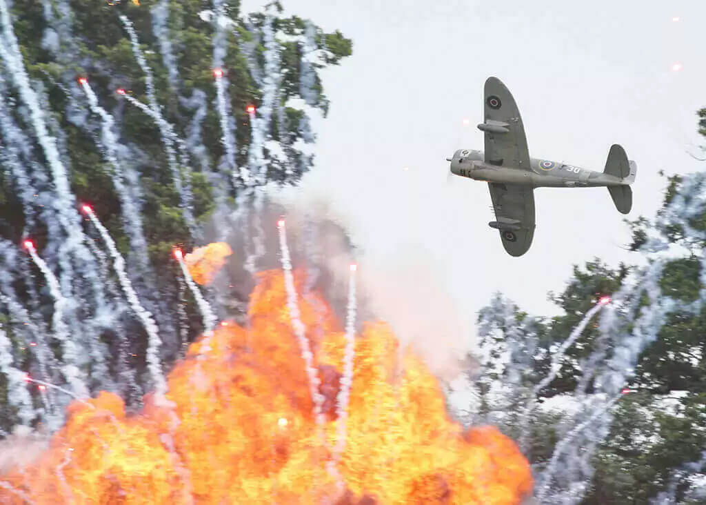 Pyro explosions and aerial fireballs for War ReEnactment with ghengis fireworks at Headcorn Aerodrome Kent